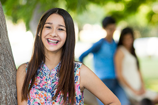 Smiling teenage girl with long brown hair.